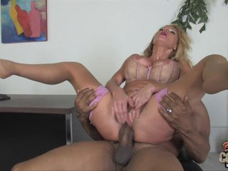 Slutty MILF beside glum unmentionables has an interracial copulation beside an assignment